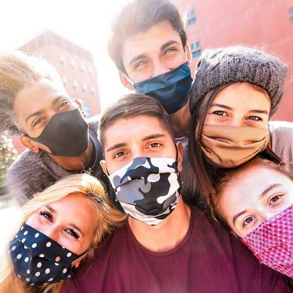 multiracial-friends-taking-selfie-with-face-masks-P84ZXFQ